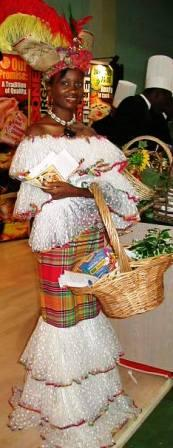 Woman wearing fancy Caribbean costume and carrying a market basket full of Caribbean food.  Jamaican food.